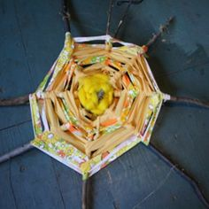 A Giant Woven Sun is like a giant God's Eye, because all you need is sticks and scraps to weave a giant sun! Kids nature crafts like this teach children about nature and make lovely outdoor decorations for summer. Outdoor games and #crafts are beautiful and fun for #kids in the #summer.