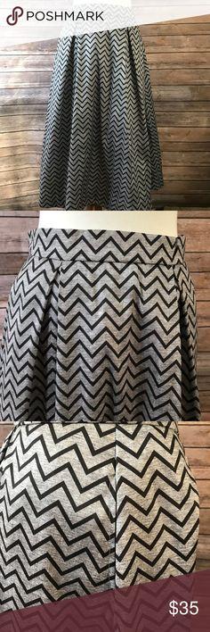 "Eshakti grey and black chevron skirt with pockets Eshakti grey and black chevron skirt with pockets  Approximate measurements: 30.25"" long 29"" waist 46"" hips eshakti Skirts A-Line or Full"