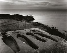 """Pictured: These early-medieval stone graves near Heysham, Lancashire, may be familiar from a Black Sabbath LP cover. For Sheila Rock they evoke many subsequent deaths, including those of the Chinese cockle-pickers in nearby Morecambe Bay in 2004. """"When the water comes in, anyone caught gets enveloped by the sea."""" Viking remains are also found near where St Patrick is said to have landed. """"It's hugely atmospheric"""""""