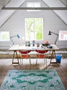 attic remodel: office design for two with bright chairs and floor rug