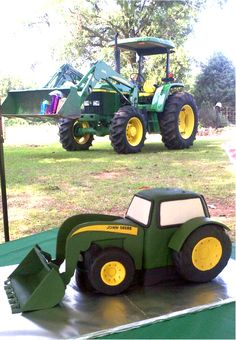 John Deere grooms cake idea and i like how they put the gifts in the bucket of the real tractor