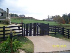 Wood Driveway Gate : Prevent unwanted guests from driving up to your home.  This arched driveway gate includes a digital keypad and gate locks for additional security.  Solar panels installed.  No electricity required!