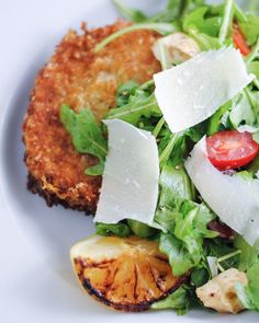 Simple pork Milanese with arugula, tomato and mozzarella salad. Top with Parmesan and serve with a charred lemon for an easy dinner that's sure to impress. Pork Milanese, Pork Loin Chops, Pork Cutlets, Italian Chef, Italian Recipes, Mozzarella Salad, Arugula Salad, Pork Recipes