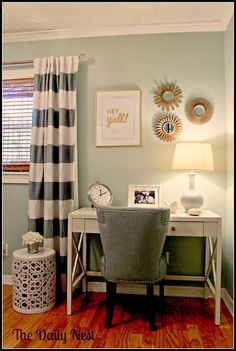 I like what looks like a minty wall color combined with white and grey striped curtains. Cute combo.