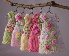 Everlasting Garden, a collection of five hand knit and embroidered dresses for teeny tiny Amelia Thimble dolls.  cindyricedesigns.com