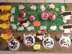 Our farm wall!  Balloon pigs  Fluffy sheep Plate cows  Feather boa chickens  Scarf and wool and stick horses