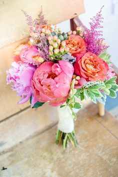 Colorful bridal bouquet with pink and purple details.