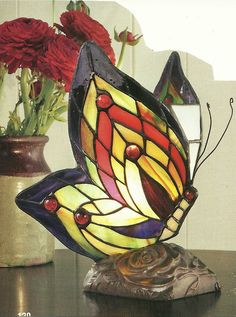 I like this stained glass butterfly lamp!  So pretty!