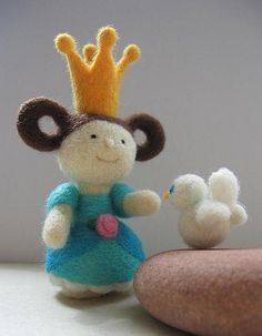 princess feeding her dove by Ola Smith.   The princess was included in a Spanish book on needle felting.  (See earlier in photo stream.)