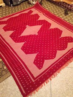 Authentic Moroccan Magic carpet made from cotton and wool two techniques of work: embroidered and waved. Made by ladies in the South of Morocco. Perfect for the floor or bed cloth. 2m by 2m or approx 6.5 feet by 6.5 feet. $425.00 Please visit us on facebook as well to view more items and tips and facts about Morocco! https://www.facebook.com/genuinemorocco?fref=ts