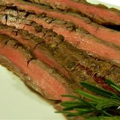 Grilled Balsamic and Soy Marinated Flank Steak Recipe- Tried it and loved it!  I refrigerated the meat in the marinade for about 8-9 hrs. before cooking it and it was delicious.  =)