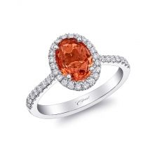 The centerpiece of this beautiful ring is a stunning 1.78CT oval padparadscha sapphire surrounded by diamonds. Set in platinum. - See more at: coastdiamond.com #coastdiamond