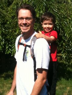 Dad carrying son on the Piggyback rider carrier