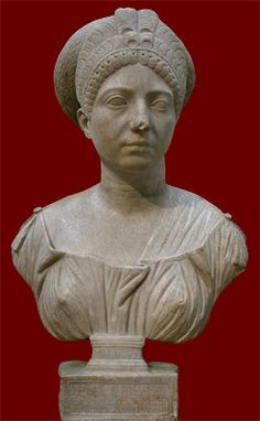 """Marble portrait bust of Claudia Olympias; Roman, early second century CE; side view. The inscription reads MEMORIAE CL[audiae] TI[berii] F[iliae] OLYMPIADIS EPITHYMETVS LIB[ertus] PATRONAE PIENTISSIMAE (""""Epithymetus, her freedman, set this up in memory of Claudia Olympias, his most dutiful patron"""").  London, British Museum."""