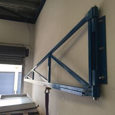Jib folded away against wall - workshop crane jib. Tags: crane, jib, diy, custom, made, wall mount, 12v, winch, ball bearing, counter lever, home made, 500kg, articulated, home, garage, workshop, dolly, rollers, bench, welding,