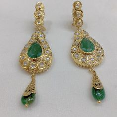 Morocco | Traditional earrings with gold and darkgreen gems, arabian jewelry, Maghrebian jewelry.