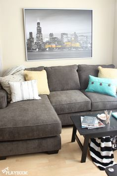 Dark gray couch with yellow and blue accents