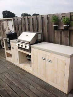 Outdoor Kitchen Ideas - Not this but something like this to slot gas BBQ into for outdoor cooking. Hide the gas bottle too. Simple Outdoor Kitchen, Outdoor Kitchen Bars, Backyard Kitchen, Outdoor Kitchen Design, Home Decor Kitchen, Kitchen Ideas, Outdoor Kitchens, Bbq Kitchen, Parrilla Exterior