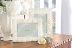Flirt with floral. White Floral Tile Frame features a stylized floral motif and a bright white ceramic glaze. Frame designed to hold 4 x 6 inch horizontal or vertical photo. Easy screw turn leaf plates on velvet back for photo insert. Beautiful keepsake hangs or displays easel style. Attractive frame is made out of high gloss ceramic. Perfect gift is gift boxed and is ready for gifting from Grasslands Road #Wedding #Glass #GiftBox #picture #LoveIs #EverydayLife #GrasslandsRoad