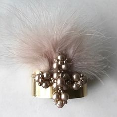 The stunning cross on the Adele Cuff is created from dusty pink Swarovski glass pearls. These beautiful pearls are wired by hand into a signature. Dusty Pink, Adele, Cuffs, Swarovski, Pearls, Beautiful, Dusty Rose, Beading, Wristlets