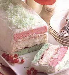 NEAPOLITAN X-MAS CAKE  Cake:  1 cup cake flour (not self-rising)  1/2 cup ground almonds  1 teaspoon baking powder  1/4 teaspoon salt  8 egg whites (about 1 cup)  1/4 teaspoon cream of tartar  3/4 cup granulated sugar  1/4 teaspoon almond extract  Green and red food coloring    Filling:  1 teaspoon unflavored gelatin  1 3/4 cups heavy (whipping) cream, divided use  3 tablespoons confectioner's sugar  1/4 cup strawberry jam  Garnish  3/4 cup sweetened flake coconut