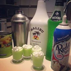 THE SCOOBY SNACK  1/2 oz. (15ml) Midori Melon Liqueur  1/2 oz. (15ml) Malibu Coconut Rum  Splash of Pineapple Juice  & Whipped Cream