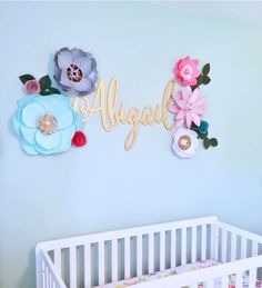 A personal favorite from my Etsy shop https://www.etsy.com/listing/541267776/giant-paper-flower-wall-decor-baby-kid