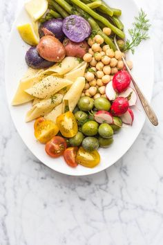 This easy vegetarian Summer Pasta Salad with Dill Vinaigrette is the perfect accompaniment to your summer grill outs. Serve it Nicoise Salad style or toss everything together for a more traditional serving option. Made in partnership with Alessi Food.