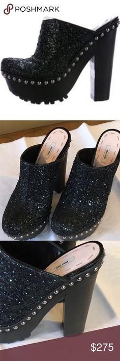 "Miu Miu Glitter Platform Mules/Clogs Beautiful Black glitter Miu Miu platform mules with round toes, patent leather trim, silver-tone rivets at outsoles and wooden block heels. Includes box. Heels: 6"" Platforms: 2""  With platform like a 4 inch heel. Size 37.5. Fits like a 7.5 or 8. Miu Miu Shoes Mules & Clogs"