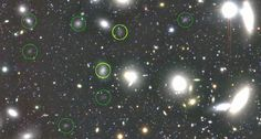 GALAXY QUEST Eight dark galaxies (circled) are among more than 800 that lurk in a tiny part of the Coma cluster (pictured). The two circled in yellow were discovered in an earlier study. ~~ NAOJ