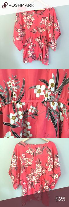 """Satiny Coral Blouse Satiny Coral Blouse with dogwood? Flower Blossom design // sz S // Notations brand // 100% polyester // flowy open sleeves, which makes it 34"""" across armpits / 26.5"""" length / elastic waist is 14.5"""" Laid flat and stretches easily to 19"""" // not my size. Can't model. // a few very small minor spots that didn't photograph well. Not noticeable // 20% off 3+ Bundles // offers welcome! // Same Day or Next Day Shipping!! 6.27.25 No trades Notations Tops Blouses"""