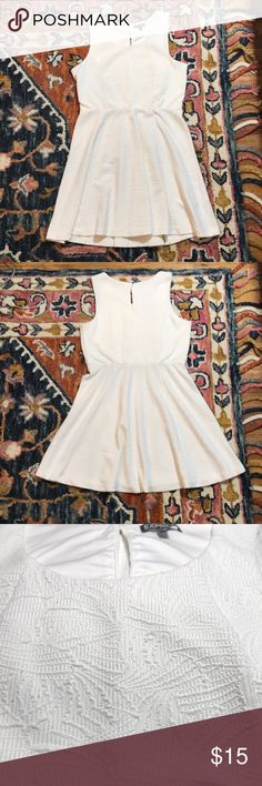 Express White Jacquard Skater Dress Button keyhole on the back. Has small string loops for a skinny belt on either side of the waste (can easily be cut off). Express Dresses
