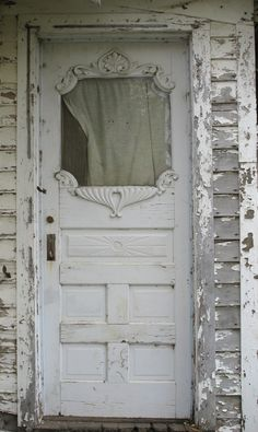 Shabby white old door