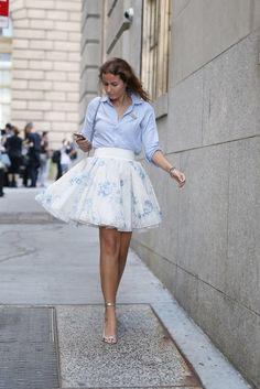 Best #streetstyle @ Spring 2015 Ready-to-Wear #NYFW | a blue button-up shirt paired with a white tulle mini skirt and metallic ankle strap sandals