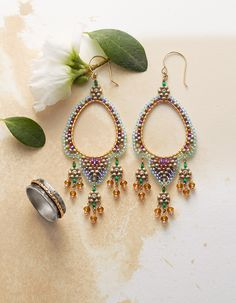 Avalon Earrings - These beautifully crafted Miguel Ases hand-beaded earrings exude a captivating grace.