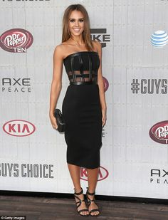 A different look for her! Jessica Alba smoldered at the Guys Choice Awards in a black strapless number, which featured leather cage-like detailing and sheer panels on the top-half http://dailym.ai/1mx6iiG