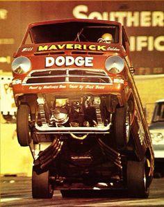 """Bill """"Maverick"""" Golden in his Dodge van wheel stander."""