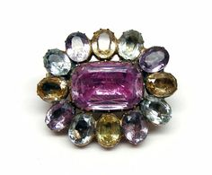 Antique coloured topaz oval cluster brooch, c.1780 …  Central oval cut pink topaz, to oval cut yellow, blue and violet topaz cluster surround, closed set in gold. Image SJ Phillips