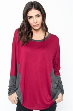 Featuring the most appropriate mixture of colors, we are smitten with basic silhouettes that have a playful look. Easy to pair with your denim or leggings, this tunic is a refreshing addition to your tunic collection.COLORSCharcoal/Heather GreyCharcoal/BlackOlive/BlackBurgundy/CharcoalSIZES (This garment runs true to size)Small 0-4Medium 6-8Large 10-12X-Large 14-16Model is wearing a size Small.