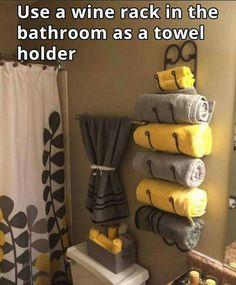 Use a WINE RACK for a BATHROOM TOWEL HOLDER....awesome idea! What do you think? via Housekeeping 101