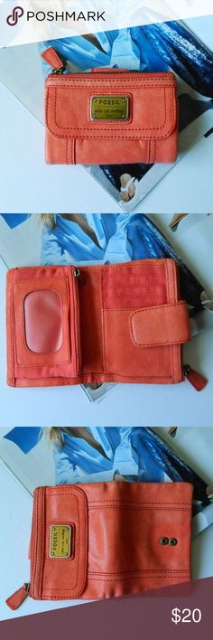 """Fossil Lamb Hide Leather Coral Small Wallet In good pre-owned condition Fossil wallet. Measures approximately 5.5"""" x 4"""" closed and 8"""" x 5.5"""" opened. Leather is very soft! Lots of pockets! There are signs of wear but the inside is very clean. Great for spring! No trades. Open to reasonable offers via the offer button. Happy Poshing! Fossil Bags Wallets"""