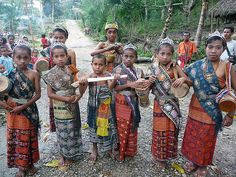 Children of Bokong in West Timor dressed for traditional dance in traditional textiles