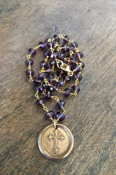 Beautiful purple beads are wire wrapped with gold chain featuring a lovely bronze cross coin pendant (Truly Blessed stamped on reverse). Gorgeous vintage style and beautiful detail.  Measures 18 inches in length.  I use only top quality beads and lead/chromium free leather in my work. Thanks for visiting...