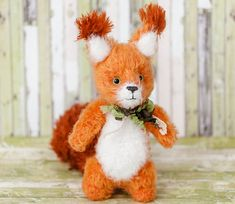 Crocheted squirrels made of fluffy wool of orange color. A knitted squirrel cute toy has a large tail that helps it stand. A stuffed squirrel doll is made from children\'s y... #crochetanimal #animaltoys #knittedtoy #toys #handmade #stuffedanimal #crochetdoll #plushtoy #amigurumi #babygifts
