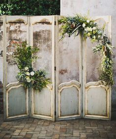 10 Unique Statement Walls for Your Wedding Decor | Do not throw out those old closet doors! Turn them into a DIY project for your wedding day. Apply paint if necessary, but let the tarnish and distress shine through with fresh greenery to complete this stunning vintage backdrop.