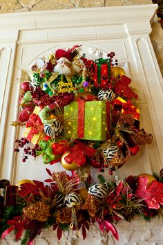 Mark Robert's Merry Christmas Fairy is a whimisical touch in a wreath