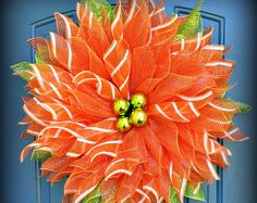 What a beautiful way to say Spring is here, this flower wreath is just the way to do that. They look wonderful on doors, windows and even on