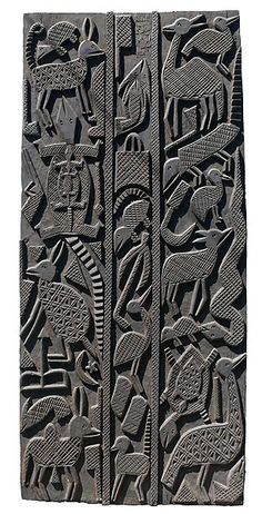 Door, Nigeria -- a geometric sort of representational art. Probably something you would see in early atorran art & architecture.