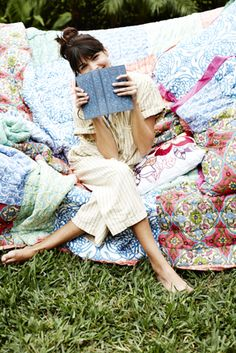 Cover a hammock with blankets and pillows for an outdoor read
