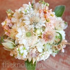 protea, scabiosa in peach bouquet